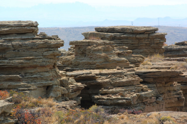 Stacked rock on top of the rim rocks.  Midwest, Wyoming